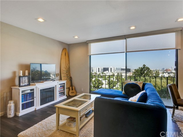 Magnificent view!! at the amazing prestigious full-service 100 S. Doheny Tower. Adjacent to Beverly Hills, West Hollywood. Nestled high on the 7th floor, this newly renovated 2 bd/2 ba condo, including brushed brass accents, stainless steel appliances, quartz counter-tops and engineered wood floor. Double sliders lead to a sweeping balcony boasting panoramic city and mountain views. This luxurious urban retreat is walking distance to world-class shopping and conveniences. The Beverly Center, Trader Joe's, Bristol Farms, Robertson Boulevard, Rodeo Drive, Cedars-Sinai and Ralph's are just some of the neighbors. Resident amenities include private storage locker, 24-hour security and concierge, 2-car tandem parking in secure garage, lap pool, spa, tennis court, gym and lobby. Photo's were taken prior to being vacant.