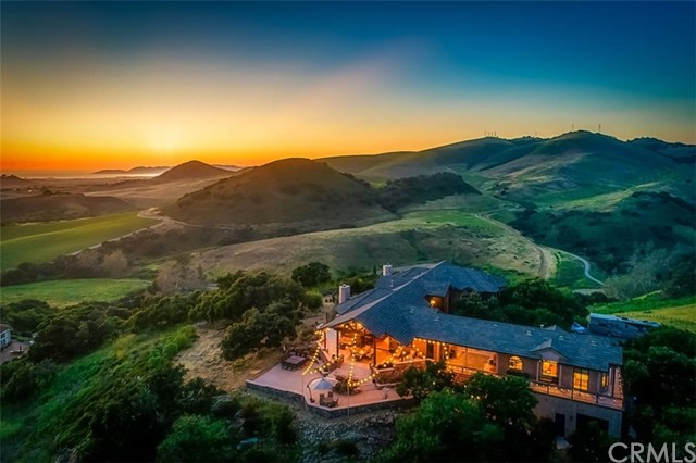 This 10+/- acre property is located on the Central Coast in the gated community of Rancho Nipomo, just minutes to the beach. 360 degrees of rolling hills, vineyards and ocean views are the backdrop to this coastal mountain retreat offering a comfortable rural lifestyle with all the conveniences of city living. This 4792+ /sf., 5 bedroom, 6 bath custom-built home has quality finishes and exceptional design with a warm, inviting feel. The expansive travertine, rock patios and multiple balconies allow for extraordinary entertaining and also private moments that capture peace and tranquility. The main home boasts a gourmet kitchen with walk-in pantry and a large quartz-topped island with seating. The kitchen opens to a large dining area and great room with a wood-burning rock fireplace and 20 ft. vaulted wood ceiling. The huge master suite has a fireplace, large walk-in closet, vaulted ceilings and its' own private balcony. Master bath has a soaking jacuzzi tub, dual sinks, steam shower with dual shower heads and granite bench. The separate guest home with living area, gas fireplace, bedroom, full kitchen, laundry and 3/4 bath is perfect for an in- law quarters or weekend guests. Private 440 +/- sq. ft. wine lounge with 1,100 + bottle storage, climate controlled wine cellar, adds to the ultimate in entertaining. This property is sure to exceed your expectations! View 3D Tour link