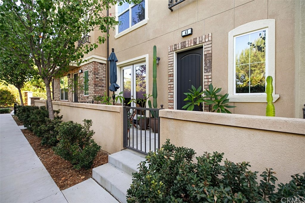 Just in time for the holidays is this highly upgraded home offering 2 bedrooms, 2.5 baths PLUS a LARGE DOWNSTAIRS DEN/OFFICE with French doors, a 2-car attached garage & front patio. Exquisitely appointed with superior upgrades, all professionally designed to create a relaxed & calming ambiance. Custom finishes are seen throughout this home; wood floors, plantation shutters, plush carpet & more. The main level offers an upgraded kitchen with granite counters, handsome cabinetry, all stainless appliances, ample counter space & separate eating area. The home is also equipped with a wonderful balcony off of the kitchen. The living room flows seamlessly from the kitchen & features light-catching windows. Natural light fills the entire home & the open floor plan provides the perfect flow for entertaining.  A powder room completes the second floor. The third level features the master with ceiling fan, updated bathroom, walk in shower, separate soaking tub, dual sinks & a walk-in closet. The second en-suite bedroom is perfect for guest with ample closet space  & updated full bathroom. The home also has it's own laundry area with full size washer/dryer which is included. Attractively priced, this is an appealing opportunity in all regards. Enjoy the amenities the community has to offer.  Pool, spa, BBQ's, a wonderful & relaxing sitting area with fireplace & a play area for the kids.  Super close to Target where you can get all your shopping done without even getting into your car.
