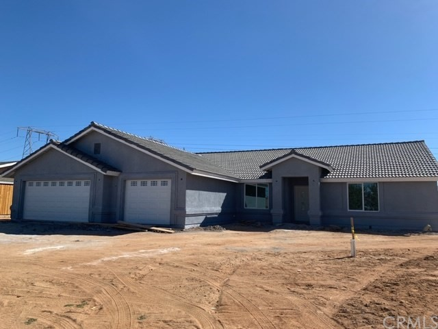 ELEGANCE IN HESPERIA. This brand new home is now ready for a family to start creating memories in it. As you walk in through the front door you are greeted with a spacious floor plan, natural lighting and a little bling. On one side of the home you have three generously sized bedrooms and a bathroom that you will fall in love with. The master bedroom that features an amazing walk-in closet and bathroom are clear on the other side of the house. The home is hooked up for solar and wi-fi to control items inside your home from your phone. There was no detail left out when this home was built!!