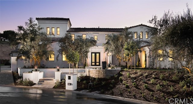 BRAND NEW ESTATE HOME! Experience the finest in luxury living in the newly completed Estate on a quiet cul-de-sac on the hillside of Orange County's prestigious Shady Canyon community. Behind the gates, drive along winding roads with natural rugged surroundings before arriving at your NEW Santa Barbara-style 9,158 sf estate, nestled on an expansive 28,088 sf lot. The inviting open floor plan, with 14 foot high ceilings and oversize windows, sliding pocket doors, and custom french doors, provides spectacular canyon views out toward Newport Beach. Upon entry, one is struck by the contemporary, clean interior style. The floor plan gracefully compliments an expansive yard with a luxury pool and spa. Family and guests will enjoy 6 spacious bedrooms, 7.5 baths, a 6-car garage, Private Office, Gym, Home Theater, Tower Loft, large Great Room and adjoining Dining Room. The large Gourmet Kitchen, with back kitchen, and Family Room connect to 2 adjoining California Rooms. A ground-level junior master suite boasts large double-doors opening directly to the pool deck. The Master Suite includes a private covered deck with contemporary fireplace, master bath, and large walk-in closets. White Oak floors, Custom Granite Counters and Cabinets, Designer Appliances and Fixtures, prewiring for SMART home technology are just a few of the custom features. 24 hour security and gated. Only minutes from the beach, Tom Fazio-designed golf course, airport, freeways, and world-class shopping and dining.