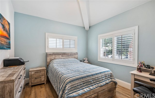 NW Bedroom has vaulted ceiling, shutters & track lighting