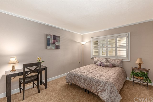 This is the guest bedroom.  It has new neutral tone carpet, plantation shutters and a large closet.