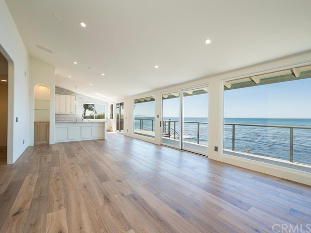 This is your chanceto own an ocean front property in the heart of picturesque Shell Beach! This impeccably-renovated beach estate consists of 3 levels, each featuring high-end materials and finishes, smart home capabilities, panoramicocean views, and private beach access! 2171 Shorelinefeatures an open floor plan concept with exquisitely designed chef's kitchen boasting quartzite countertops, custom cabinetry, glass pendant lighting, large island, glass backsplash, and all stainless-steel modern appliances. Flowing from the kitchen you'll find the livingroom with gas fireplace, wood flooring, floor-to-ceiling view windows and sliding doors, powder room, and owner's suite #1 with travertine flooring, sliding glass doors and ocean views, en suite bath with tub, walk-in shower, and walk-in closet. Venture to the entry level to find two guest bedrooms, and guest bathroom. On the lower level you will find a spacious family room with sliding glass doors to enjoy the backyard and ocean views, gas fireplace, office or media room with refrigerated wine cellar, and laundry room. Located off of the family room is the recently remodeled owner's suite #2 with a walk-in closet, smart TV, ocean view sliding doors, and sparkling en suite bathroom with quartzite countertops, mosaic glass tile flooring, walk-in shower, and dual vanities. The outdoor amenities include a maintained seawall, private beach access, spacious stone paver patio, outdoor fireplace, hot tub, and much more!