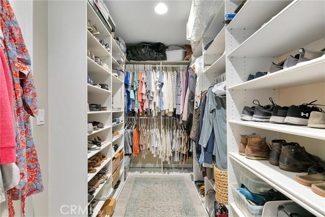 Huge walk-in master closet - professionally organized.