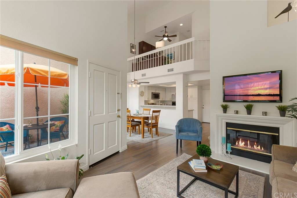 """Beautiful Turnkey Townhome in Laguna Audubon Seacliff Court; a Serene Tree Lined Community minutes to Laguna Beach & Irvine Spectrum! Popular 2 Bedroom, 2.5 Bath plus Loft/Office/Den features Soaring Ceilings, Premium Laminate Flooring on Lower Level, newly Remodeled Kitchen (2019) with Granite Counters, Breakfast Bar, Cabinetry with soft close features, Pantry with pull-out shelves, Stainless Appliances, Coffered Ceiling & Recessed Lighting. Living Room has soaring Vaulted Ceiling & Abundance of Natural Light, Top Down, Bottom Up Shades, Gas Fireplace enhanced with Rich Glass Fire Beads.  Dining Area with High Vaulted Ceiling, Lighted Ceiling Fan & access to Relaxing Courtyard Patio. Downstairs Powder Room Remodeled 2019. Upstairs Second Bathroom Remodeled 2018. Large Master Suite with Walk-in Closet, Lighted Ceiling Fan & Top Down, Bottom Up Window Shades. Remodeled Master Bath (2018) includes Dual Sink Granite Vanity & Full Size Walk-in Shower with Glass Enclosure. Secondary Bedroom features Mirrored Wardrobe Closet & 2"""" Shutter Blinds, both Bedrooms feature Vaulted Ceilings. Loft makes a perfect Office, Den or Play Area for the Kids! Additional features include: Full Size Laundry Closet, 2-car Direct Access Garage, Re-piped with PEX, Newer Dual Pane Windows & Doors, Energy Efficient HVAC System, Garage Door Opener all added in 2018!  Community Pool, Spa, Tot Lot & lots of Guest Parking! Approx. 6 mi. to Laguna Beach, Nearby Irvine Spectrum, Toll Rd, Freeway, Parks & More."""