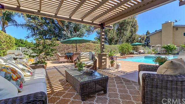 Enjoy a summer day under the patio cover and looking off on the gardens/pool.
