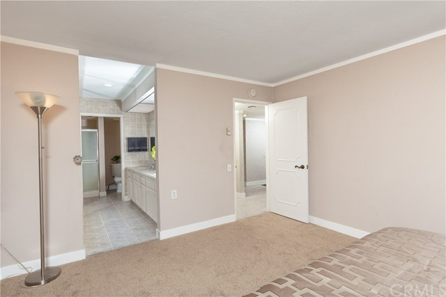 The Master Bedroom has an en suite dressing area and bathroom with stall shower.