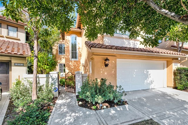 12161 Hermon Drive is a Beautiful Dream Home Located on an Interior Cul-De-Sac Lot within the 24-Hour Guard Gated Community of San Miguel in Tustin Ranch. Showcasing One of the Most Desired Floor Plans, The Home Features Three Bedrooms, Two and a Half Bathrooms, Soaring Ceilings, Wood Floors, a Spacious Yard and Owned Solar. The Kitchen Enjoys Upgraded Stainless Steel Appliances, Granite Countertops, Island with Seating, and Opens to the Family Room with Backyard Access, Perfect for Entertaining. The Dining Room Opens to the Formal Living Room which includes a Remodeled Fireplace and Vaulted Ceilings. The Private Master Suite Showcases a Walk-In Shower, Dual Vanities, Separate Tub, and Walk-In Closet. The Private Backyard Includes Beautiful Landscaping, Patio, and Grass Area. Attached Two Car Garage. The San Miguel Community Boasts a Recently Renovated Resort Style Pool and Spa.  Nearby Award-Winning Schools, Tustin Ranch Golf Course, Tustin/Irvine Marketplace, Peters Canyon Park, Hiking and Biking Trails. Easy Access to the 5/55 Freeways and 261 Toll Road. 12161 Hermon Drive is a Must See!