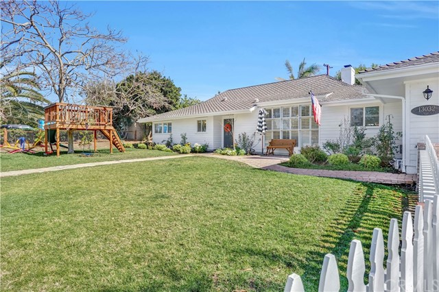 Charming North Tustin ranch style home is ideally located steps from the popular Esplanade walking trail and close to award winning schools.  Extensively updated throughout, this impressive home has approximately 2,600 square feet with four bedrooms, three bathrooms and expansive open living spaces. The gourmet kitchen offers brilliant white cabinetry, marble counter tops, chef's range and a large island with wine fridge that will become your families impromptu gathering spot as will the generous dining and family rooms. Both the living and family rooms have easy access to the backyard with its remodeled pool, spa, patio, built-in barbecue and grass for your pet as they lounge under fruit bearing trees. Beautiful wood floors embrace all of the common areas while upgraded designer carpeting completes the four bedrooms. Newly renovated baths of classic design are sure to offer tranquil privacy.  The homes energy efficient solar system  along with upgrades including recessed lighting, fresh landscaping, painted exterior and dual pane windows make this a must see property. It's hard to find single-story homes and this one is a beauty!