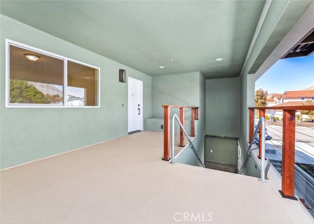 Unit 1 - single level unit entrance. Elevator access directly behind the camera.