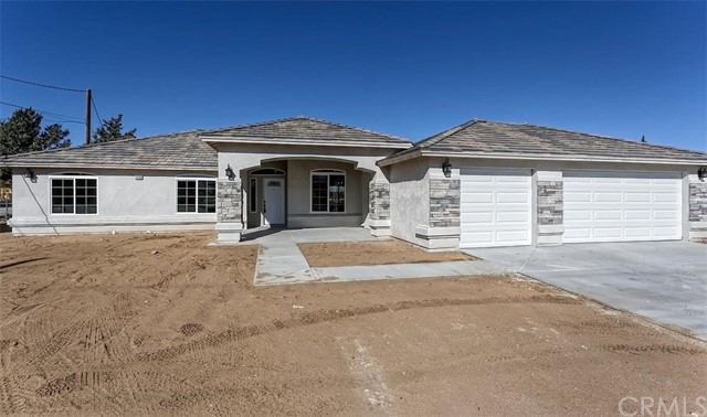 GORGEOUS New Construction situated in Hesperia. Four Bedrooms & 2.5 Baths. Master with Large Closets & Separate Modern Tub & Shower. Family Room w/ F.P & tile flooring. Large Kitchen with water fall countertop island, tile flooring, & large pantry.. Formal Dining, Breakfast Nook, Indoor Laundry & 3 car garage. Property is still under construction. Photos are of similar property. ETA is end of January or into February.