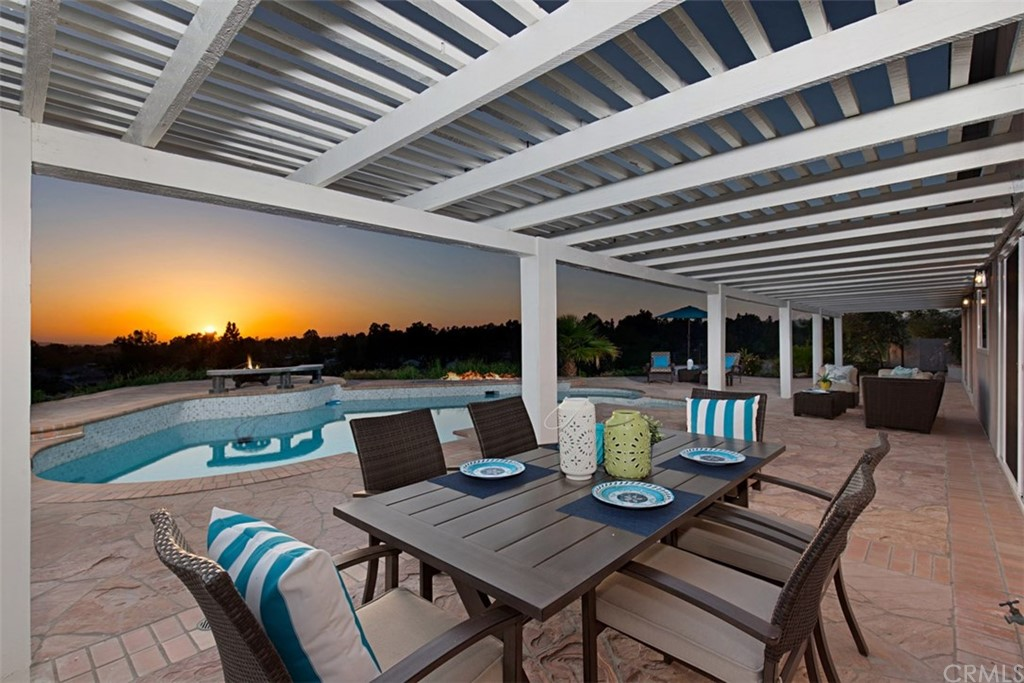 Rarely does an amazing SINGLE-STORY home combined w/a POOL & ENORMOUS PRIVATE yard with PANORAMIC VIEWS TO FOREVER hit the market. This custom home is truly an oasis for the working professional, growing families or those looking to downsize. A few of the impressive features of this spectacular home include a whole house RE-PIPE (PEX), NEW dual-pane windows, HVAC, water heater, pool equipment, including a pool solar blanket & door safety alarms. The interior living space welcomes you w/high ceilings, LED recessed lighting, trending paint colors & flooring. The kitchen is beyond-beautiful with an expansive custom white quartz island & countertop. Crisp white shaker cabinets w/Artisan porcelain tile backsplash accented w/brushed nickel hardware & picturesque windows & sliders overlooking the POOL & beautifully landscaped yard. Wake up to views from the master bedroom suite which offers a HUGE custom walk-in closet. The master bath has a modern barn door, frameless walk-in shower, extra-long vanity with dual sinks, quartz countertops & ample storage. The additional four bedrooms are generous in size, offer closets & share two baths. Inside laundry w/storage & access to the two-car garage. Situated on a large lot w/a sparkling pool, relaxing spa & gas fire pit. Two herb gardens to grow your own veggies & the grassy area is perfect for play & entertaining. Live the Mission Viejo lifestyle while enjoying epic sunsets & breezes in this luxury home w/Lake MV access. A MUST SEE!