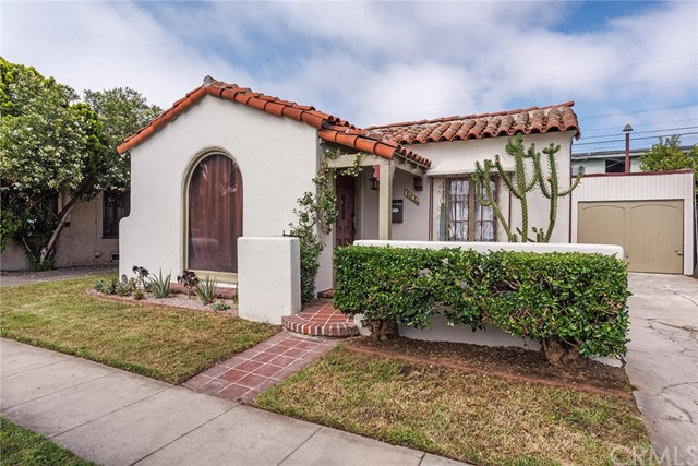 """Welcome to Minerva Park Historic District, are you looking for a charming Spanish home? Then you will love this custom Spanish Colonial Revival home that was designed in 1925.The decorative style of this home is characterized by the arched living room window and lots archways, decorative wrought-iron grill work, stucco finish & red tile roof. As you step into the sunken living room with it's Beautiful hardwood floors and barrel ceiling, you will see how the large picture window let lots of light in to show off the barrel ceilings, with a faux fireplace, you will be in love with this home, then you step up into the formal dining room, lots of original tile work in the kitchen & bathroom. The laundry is right off the kitchen.  The district's charm and small scale is reminiscent of courtyard housing. Minerva PARK Place! Minerva Park Place is a narrow street lined with 16 Spanish Colonial Revival homes. Built by street resident and building contractor Frank Smith in 1925, the district's charm and small scale is reminiscent of courtyard housing, a development style common in Southern California in the early 20th century. """"Minerva Park Place Historic District"""" is the perfect location between LA & Orange County, All within walking distance to shopping, restaurants & many neighborhood coffee houses, small-town ambiance. With a Walk Score of 82"""
