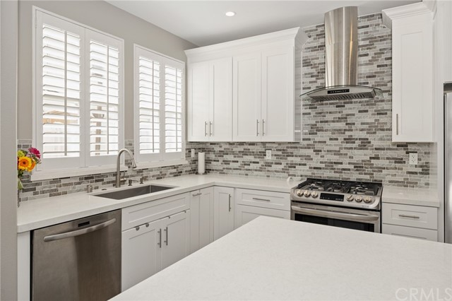 light and bright kitchen featuring stainless steel appliances
