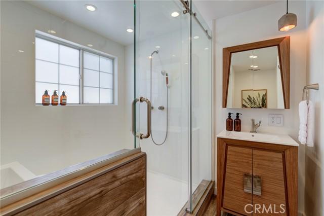 Hallway full bathroom with huge shower and soaking tub