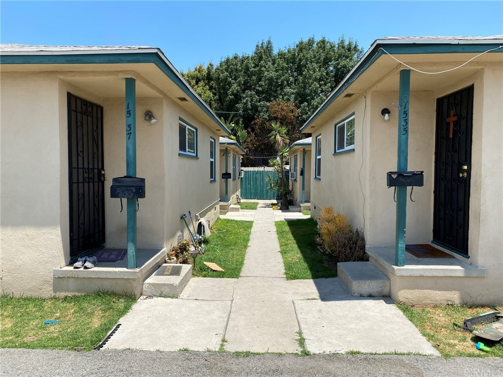 Walkway that goes between the 4 units. This listing includes the 2 units on the left and a front unit not shown here.