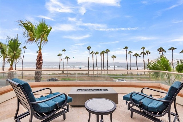 Fabulous Huntington Beach Oceanfront Location:  Panoramic 180 Degrees of Whitewater Ocean Views from Huntington Beach Pier to Palos Verdes.  Enjoy Views of Catalina Island and Gorgeous Sunsets from your Living Room, Master Suite, and Multiple Spacious Lanis.  Just steps to the Sand and Surf across the street – And a short walk to the Pier, Dining, Shopping, and Entertainment including Main Street, Pacific City, and the Famous Huntington Beach Pier.  Walk to Events at the Pier and Main Street including Pro Surfing & Volleyball Contests, Car Shows, Farmers Market, and more Outdoor Entertainment.  Enjoy a Walk on the Beach, and watch Volleyball Games and Surfers from Your Home. This 3,800 Sq ft Estate completed in 2005 offers Mediterranean Architecture Encompassing 3 Levels.  The Floor Plan is designed with 4 Bedrooms, 4 Full Baths, 3 Private Lanis, Two Staircases, and an Elevator to All Three Levels.  Attached 4 Car Garage, and Large Driveway provides Additional Private Parking.  First level offers:  A Main Floor Bedroom and Full Bath, and Living Room with Fireplace.  Second Level: Featuring the Beautifully Appointed Kitchen and Spacious Dining and Ocean View Family Room with Fireplace.  This Level has a Large Lani with Plenty of Room for Entertaining.  The Chef's kitchen includes an oversize Center Island with Granite Countertops, Custom Stone Backsplashes, Thermador Stainless Steel Appliances, Wine Refrigerator, and Pantry.  The 2nd Level also includes Two Secondary Bedrooms with Volume Ceilings - one with a Private in-suite Bath, and another with a Private Ocean View Balcony.  Third Level: This Entire Floor is your Spacious Master Suite accentuated with Volume Ceilings, Crystal Chandeliers, and a Romantic Fireplace.  Your Master Suite includes a Very Large Walk-in Closet, Spa Quality Bath, and Private Lani with Full Ocean and Sunset Views.  Live the California Lifestyle Everyone sees in the Movies and Dreams about.  When you are home - You are Instantly on Vacation
