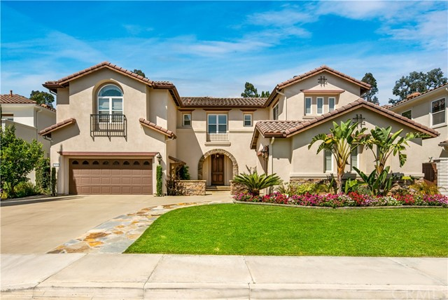 Stunning model perfect estate located in the highly desirable guard gated community Treviso in Tustin Ranch! This beautiful home is highly upgraded throughout with private entertainment backyard, swimming pool and spa, outdoor fire-pit. Gorgeous foyer area and open up to vaulted ceiling formal living room with plenty of upgrade and lots of windows with natural lights. Upgraded gourmet kitchen with granite counter top and backsplash, breakfast bar stainless steel 6 burner range, spacious family room w/custom built beam ceiling and direct access to the backyard. Downstairs guest en-suite with french doors direct access to the front courtyard. Downstairs Multi functional bonus room + office/den for home entertainment. Highly upgraded master suite mixing tranquil environment with timeless architecture. Upstairs with beautiful built in book shelves and office area. Secondary bedrooms upstairs with jack and jill bathroom. Short distance to Ladera Elementary School. Convenient to Tustin Ranch Golf Club, Tustin Market Place, freeway 5. Resort-like community amenities! Awesome school district!