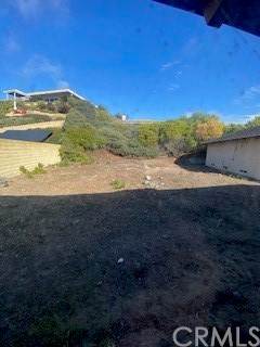 Super large back yard w hillside with possibility of creating full ocean/ coastal view deck ?/ entertainment area- sugested  ADU/ Casita to the right currently 3 car garage potential of aprox 660 sq ft ?