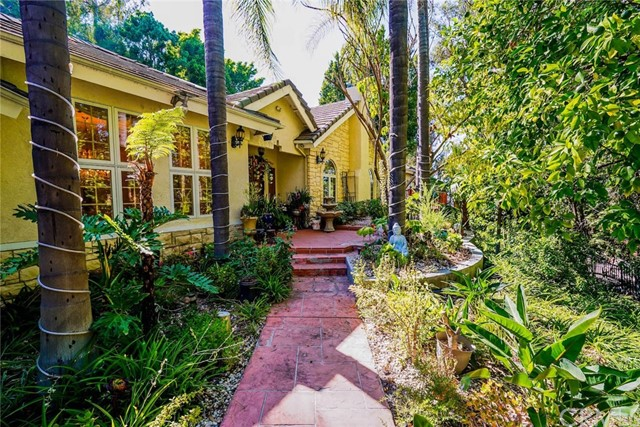 Privately enclosed on 1.2 sumptuously landscaped acres, this secluded 6 bed/4.5 bath Peralta Hill estate offers quintessential luxury living, evocative of an island hideaway. An entertainer's dream home, elegance and sophistication combine with a thoughtful, fluid floorpan for indoor/outdoor living & entertaining. Amenities include capacious ceilings, French doors, wall of glass, marble and tiger wood flooring, a media room, formal dining, living room with bar area open to the patio. Cook in the chef's dream kitchen with granite counters, island bar seating, sub zero refrigerator, 6 burner thermador range, double ovens, walk in pantry & breakfast room. Lounge in the dreamy fireside master suit, with French doors to a patio overlooking city lights. Pamper yourself in the spa like bath with sunken whirlpool tub, shower, dual sinks, vanity, walk in closets. 5 bedrooms offer walk in closets, (one currently an office could be a 2nd master). You'll love the laundry room, 3 car garage w/epoxy flooring, high tech security, surveillance and surround sound systems. Outdoor features include pool, spa, cascading rock waterfall, sitting areas, in ground built in BBQ, retractable awnings, basketball court, gazebo, batting cage, putting green. This tranquil paradise is located within the attendance area of highly rated OUSD schools, just minute from OC's best shopping, dining, entertainment.