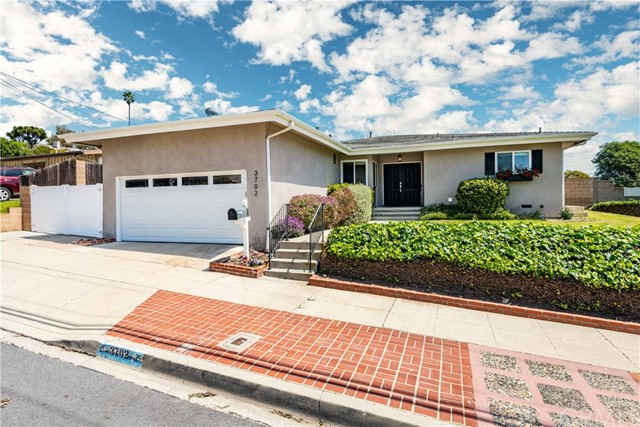 Located just steps from Paseo Del Mar, this single-level home had been completely remodeled and situated on an almost 8900 sqft over-sized flat usable lot. Gourmet kitchen with Quartz counter-tops features a BlueStar 6 burner (w/griddle) stove and other top of the line s/s appliances. All bathrooms are tastefully remodeled. Exceptional open floor plan is ideal for entertaining!!! Recessed lighting, AC, crown molding, dual-pane windows & French doors along with a newer electrical panel are some of the many upgrades this home features. Living room (w/fireplace) and dining area with French doors leads out to a brick patio and open flat grassy backyard with Jacuzzi. Mature orange, lemon and apple trees provides an abundance of fresh fruit. Catalina and ocean view from the yard and home. Two car garage with plenty of additional attic storage accessible with drop down ladder. Long side driveway allows for boat, RV or additional car parking /storage. Useful tool / storage shed located in rear yard included in sale. Come enjoy the ocean breezes and discover this gem in the South Shores!