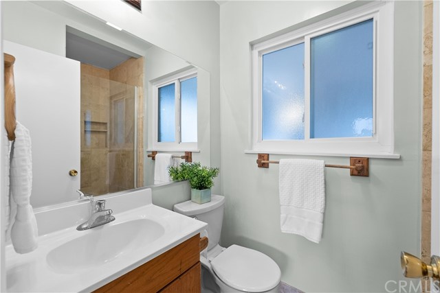 Bathroom 2 (Downstairs Master Bath) with Travertine Shower