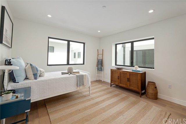 Spacious bedroom wth private bath (shown here using reverse of 961 Unit A staging)