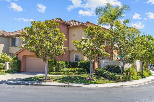 Amazing home located on a premium interior corner lot behind the prestigous guard gates in Tustin Ranch. This popular 4 bedroom plan sells quickly and offers streaming light throughout the day! HUGE wrap around yard with brand new landscaping! The spacious light & bright living room features volume ceilings & walls of windows opening onto a charming dining room. The kitchen is open to the family room and is a great space to entertain. Custom features include slab granite counters, a tumbled stone backsplash, white cabinetry, stainless steel gas cooktop with custom hood & stainless steel dishwasher. The newer french sliding doors lead from the breakfast nook to the spacious patio and sprawling private grassy yard. Convenient main floor laundry room & powder room on the first floor. The master suite features trey ceilings, two spacious closets and a luxury master bath with dual vanities, a soaking tub and tumbled stone shower.  Custom upgrades include plantation shutters, ceiling fans, custom closet organizers, wood laminate flooring, new carpet and new bathroom/dining room light fixtures. This home is just a block to top ranking Ladera Elementary school & Pioneer Middle School. Both located just outside the back gates. Your kids can attend award winning Beckman High school!!! Walk to the private community pool & spa!!! A hop, skip and a jump away is the Tustin Marketplace offering numerous dining, movie theatres & shopping venues. Don't forget across the street is the public 18-hole Tustin Ranch Golf Club, with a clubhouse offering a pro-shop, restaurant and in summertime enjoy music under the stars concerts/bbq and Taco Tuesdays!! The Tustin Ranch Lifestyle can't be beat!!!  Tustin Ranch is centrally located in Orange County & approx. 20-30 min to the Newport & Laguna beaches, Fashion Island, South Coast Plaza shopping, theatres, Anaheim hockey & baseball venues. This is the place you want to live!!
