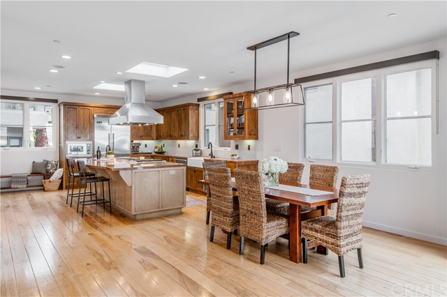Dining area adjacent to kitchen and living area.Panoramic doors lead to outside decks, but you can enjoy the views while dining, cooking, lounging inside!