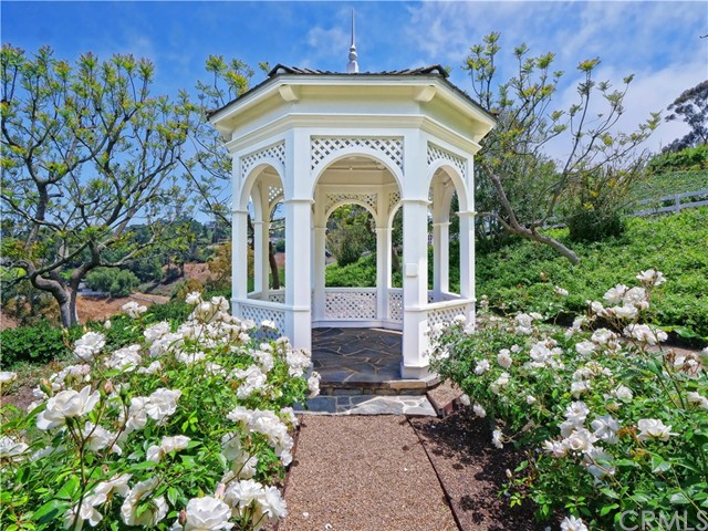 Gorgeous lush landscaping lead to the private gazebo