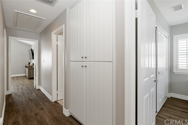 linen storage in upstairs hallway with access to attic