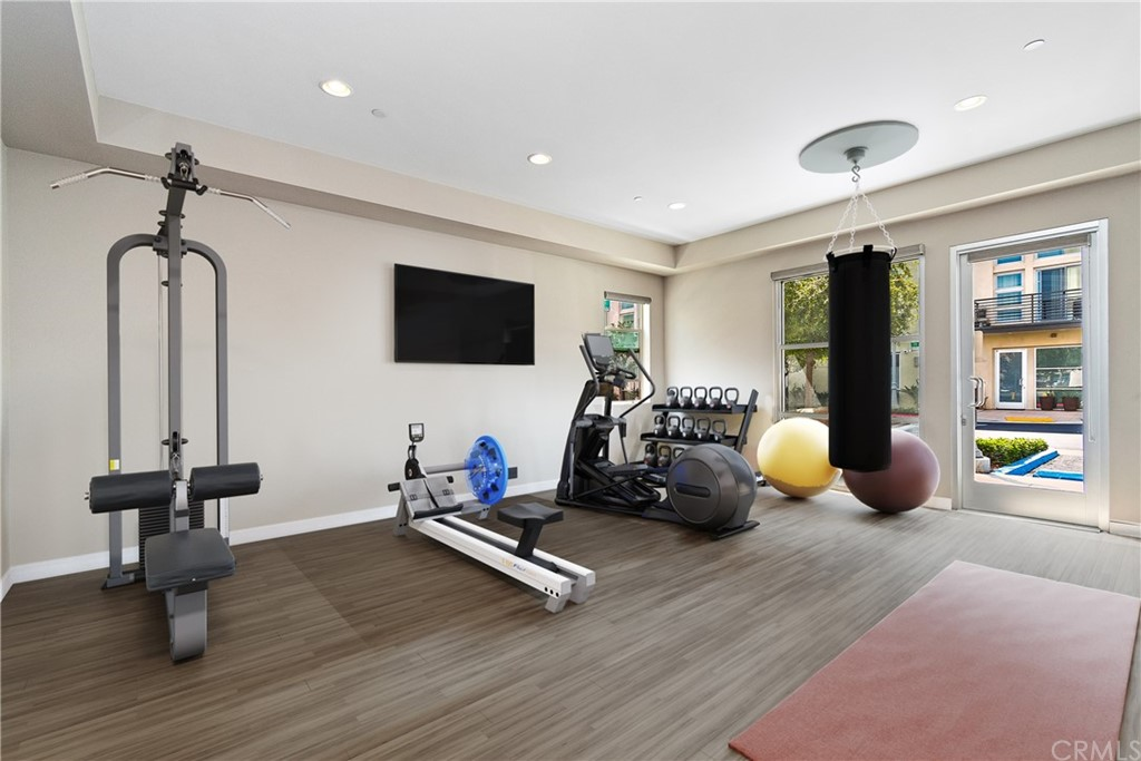 'Virtual Staging to illustrate home gym/business possibility of first floor.