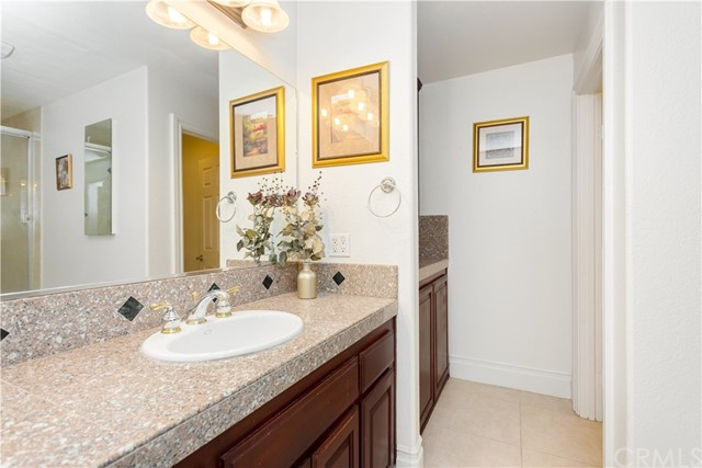 lower Level Guest Bathroom with Granite Counters and extra Linen Storage