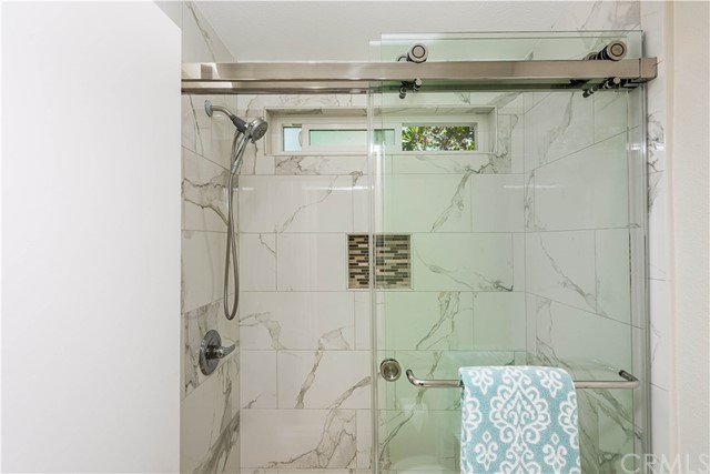 Enjoy the extra large shower! The barn door style shower door adds some flair to the room!