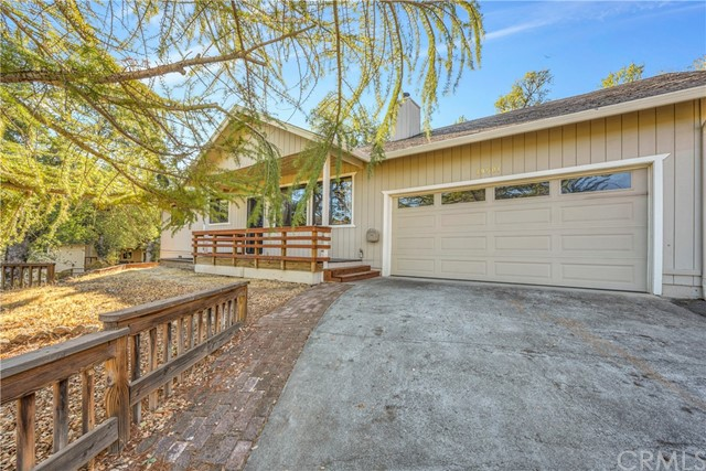 Ready for a treat? This updated 3 bed / 2 bath home with 1,440 SF sits on just over 1/3 of an acre offering sophistication, privacy & convenience! Ideally located near gate access, with community amenitiessuch as the equestrian center, park, driving range/pro-shop and little league field just around the corner! Upon arrival notice the beautiful tree studdedparcel, fenced yard, 2 car garage & shop+ covered carport! The open concept living room offers newer laminate flooring, soaring vaulted ceilings, eye-catchingwainscoting and a wood burning stove that keeps the home toasty all winter long! The kitchen has custom cabinets with loads of storage, newer appliances and faux granite countertops with custom tile backsplash. The adjoiningdining area has a sliding glass door that leads out to the back deck & patio, covered by a large pergola with a beautifulwaterfall feature running down the hillside for your outdoor enjoyment. Delight in the fruit trees on drip - apple,fig, olive, mint & grape to name a few! The indoor laundry room with large built-in shelving unit is a bonus! Head down the hall to find 3 comfortable bedrooms and ahall bathroom that has been updated with tile flooring, newer vanity and spa-like tile shower. The primary suite boasts a dreamy walk-in closet, access to the back patio via sliding glass door & adjoining bathroom with linenpantry that is sure to please! New water heater is a bonus! Take a stroll on the neighboring utility road where you can enjoy the valley views and fabulous sunsets that Hidden Valley Lake is known for!