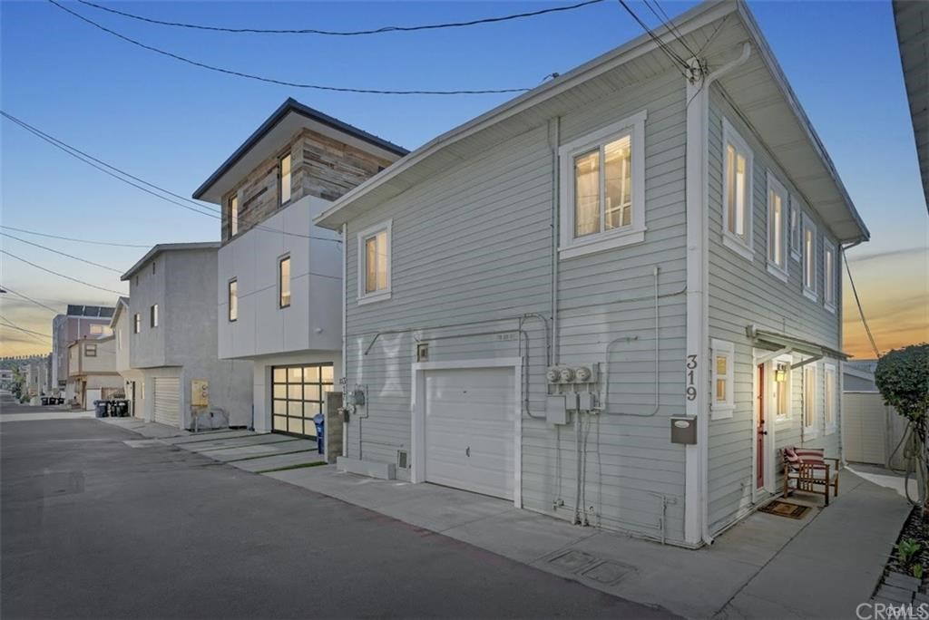 This sweet property oozes vintage storybook charm. North side of a 1920's charming duplex with modern touches:  1 bedroom with an ocean view peak, loft space for office or den, 2 bathrooms, granite countertops, hardwood floors, all-in-one-washer/dryer, brick patio with storage shed, and is located just a few short blocks to the beach.  Location is key.