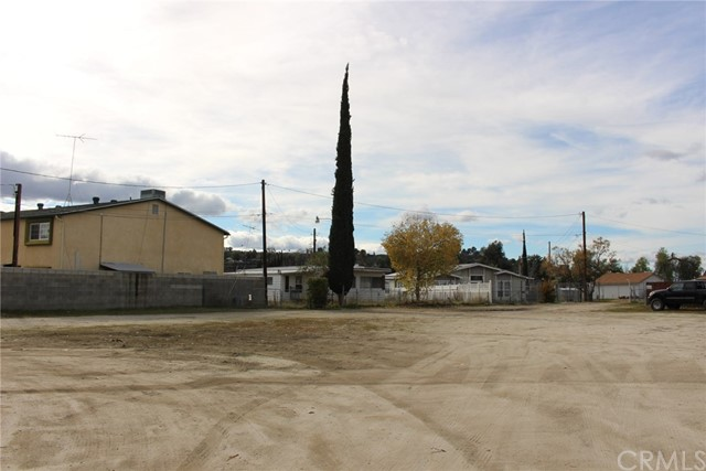 Don't miss a great opportunity to purchase a .14 acre lot (6098 Sq. Ft.) lot with an old pull-off manufactured home.  It can be replaced with a new manufactured home or a stick-built home.  Any home built there would have a beautiful view of the mountains.  All of the utilities have been developed on the land, with a two-car garage, and storage sheds.  The lot is currently fenced by chain-link, block, and vinyl.  We have an appraisal that was completed on 9-18-2019.