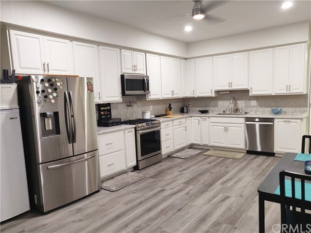 Lower level kitchen with new floors, soft close cabinets, pull out spice drawer and all new appliances