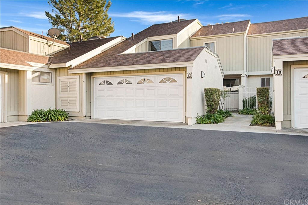 Fabulous location in the great community of Indian Hills and adjacent to Sheep Hills Park! This home is placed on a quiet cul-de-sac street with guest parking readily available. 2-car attached garage and private entry. Light, bright, open, and spacious floor plan makes this an exceptional home! Freshly painted throughout with designer colors, upgraded Pergo and ceramic tile flooring, recessed can lighting throughout, and volume ceilings in all bedrooms! The kitchen is beautifully appointed with granite counter tops, brand new stainless-steel gas range and microwave, dishwasher, and a double sink with upgraded faucet. There is plenty of cabinet space! Upstairs are three bedrooms, all an excellent size, along with two bathrooms that have been updated with spacious, designer tile in the showers. Re-plumbed with 'PEX' is another great amenity! Enjoy weekend barbeques with guests in the wonderful backyard patio or relax in the private front courtyard. This home is turn-key and ready to move into! Delight in the proximity to schools, churches, theatres, Aliso Viejo Town Center, Aliso Viejo Aquatic Center, the Toll Roads, freeways, and recreational trails spanning all the way to the ocean! This home is a single family residence - attached, which is a plus for a lower interest rate for your loan! Race to this home and make it your own!