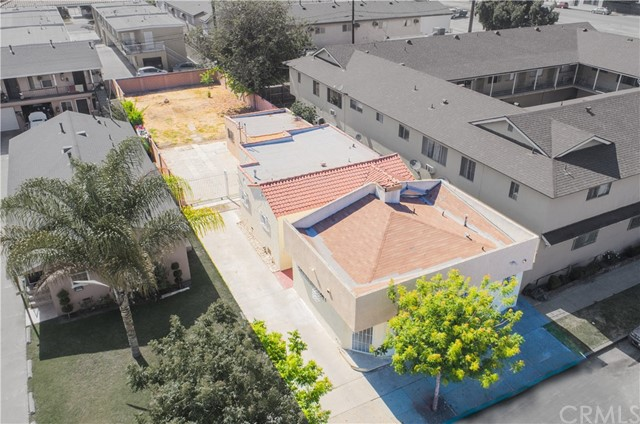 Welcome to 8615 State St in the City of South Gate.  Here is the investment opportunity you have been waiting for all year!  This mixed use duplex is comprised of 1) a storefront retail unit with its own bathroom (plenty of space to add a shower) along with 2) a 2nd residential unit with 2 bedrooms & a bonus room (previously used as a 3rd bedroom) & 1 full bath.  This is your opportunity to start the business you have always wanted OR expand your current business to another location OR live in the rear residential unit and enjoy the cash flow from the currently rented retail space.  The opportunities with this unique property don't end here....DEVELOPMENT OPPORTUNITY as Property is zoned SGCR.*  Due to the current zoning, the property's unique location, lot size etc. the City of South Gate may allow an owner to build anywhere from 2 to 4 units (Buyer to verify buildability details etc with the City).  The Residential unit is quite spacious w a separate living room, dining room, galley kitchen, indoor laundry room & 2 spacious bedrooms...3rd room was last used as a bedroom. Huge backyard just waiting for a new owner to transform this open space to build units, park tons of cars, an RV or design your very own garden oasis...Excellent location. Close to several parks & schools.  Steps away from several Metro bus lines & has a WalkScore© of 78 (Very Walkable).  This property can qualify for FHA financing.  Please ask the listing agent for additional info re fha financing.