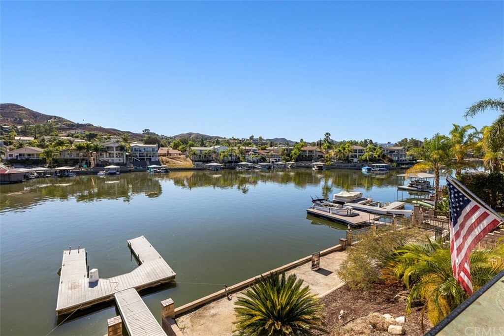 Gorgeous single story waterfront home with 70' of water frontage in the wide part of the channel.   Located on a cul de sac street, this Spacious 3 bedroom plus 2 bath highly upgraded home enjoys endless views of the East Bay! Upgrades include fresh stucco and paint, double door entry, dual paned windows, tile flooring, crown molding, vaulted ceilings, spacious kitchen with updated cabinets and plenty of storage space, granite countertops and a walk in pantry.  Enjoy expansive views from the large windows! Open concept floor plan, living room is light and bright with a custom fireplace and a large slider leading to an approx. 800 sq ft patio with great views of the lake and a sleek glass railing. The spacious master suite has a walk-in closet and remodeled bathroom with an oversized shower. Two additional bedrooms with closet organizers share the second bathroom updated with today's finest standards to complete this great home! The flat driveway features a 2 car garage with an RV panel. Canyon Lake is a 24 hr guard gated city with a private lake for wakeboarding, water skiing, 18 hole SGA golf course, equestrian center, campgrounds, baseball fields, parks & beaches, tennis & pickle ball courts, hiking and biking, senior center, clubhouse and so much more!