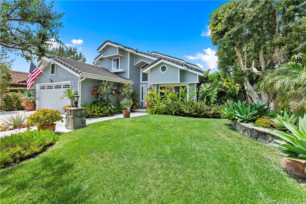 This beautiful San Clemente home is sure to catch your eye with its outstanding curb appeal and panoramic views of the hills. The attention to detail found throughout is second to none. The new furnace, new A/C, new tank-less hot water heater, total PEX re-pipe, and solar panels show that the beauty is more than skin deep. The home features four bedrooms with one bedroom and full bathroom down stairs, new windows, new banister with wrought iron supports, an updated kitchen, new beveled granite throughout, updated bathrooms, a sun room, and a great yard. Speaking of yards, this yard was featured in the San Clemente garden tour! It has a koi pond, built-in BBQ, gazebo, pavers throughout, and is landscaped incredibly! You will feel like you have transported to a lush garden oasis! Live minutes from the beach, hiking trails, great schools and more. All of this comes with low HOA and no MELLO ROOS! Don't wait because this home will not last!