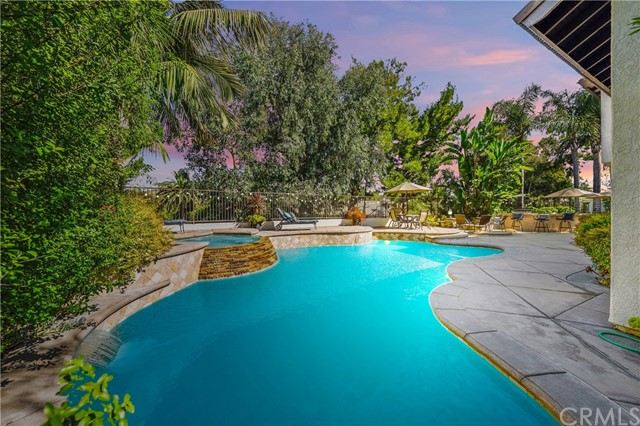***LUXURIOUS POOL HOME IN THE HIGHLY DESIRABLE GUARD GATED COMMUNITY OF BELSOMET***Impressive Double Door Entry Opens To The Elegant Formal Living Room Featuring Wood Flooring, High Ceilings And Custom Stone Fireplace. Sophisticated Formal Dining Room With Coffered Ceilings And Spectacular Views Overlooking The Sparkling Pool And Spa. Gourmet Kitchen With Stunning Cabinetry, Quartz Countertops, Double Ovens, 5 Burner Bosch Stove, Built-In Subzero Refrigerator/Freezer And Large Dining Area. Family Room Opens To The Kitchen Offering Gas Fireplace,  Built-In Entertainment Center With Wine Fridge And An Abundance Of Natural Light. Main Floor Bedroom/Office Features A Double Door Entry And Direct Access To The Downstairs Bath With Walk-In Shower And Quartz Countertops. Laundry Room With Sink Has Plenty Of Cabinetry For Optimal Storage. Upstairs You Are Greeted By The Double Door Entry To The Master Suite With Gorgeous Marble Fireplace And Walk-In Closet. Master Bath Features Dual Raised Glass Sinks, Marble Countertops, Walk-In Shower And Sitting Tub With Breathtaking Views Of the Back Yard. Three Additional Bedrooms, One With A Double Door Entry, Built-In Desk And Walk-In Closet. Secondary Bath With Double Sinks Is Perfect For The Kids To Share. Enjoy Resort Style Living In This Extraordinary Back Yard Paradise! Exquisite Pebble Tech Pool And Spa With Multiple Waterfall Features, Raised Firepit With Seating Area, Incredible Built-In BBQ With Counter Seating Ideal For Entertaining Your Family And Friends. Surrounding You In This Outdoor Sanctuary Is A Mature And Tropical Landscape Offering Optimal Privacy For Outdoor Living.  Added Peace Of Mind For Your Family In This Guard Gated Community And You Have Everything You Could Dream Of....SO CA. LIVING AT ITS FINEST!!!