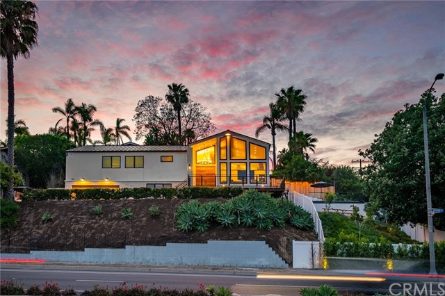 """""""Motivated Seller"""" Price Reduction! Check out instagram @indiansprings_newport-beachca . """"Views Views"""" stunning fully remodeled 4 bed, 4 bath Newport Beach home with incredible views on a large approx 12,000 sq ft lot. Enjoy the site of the picturesque """"Back Bay"""" from almost every window. This 3233sq ft  home is located in a private community of Indian Springs and sits behind an automatic gate with push button access . It features an interior designed by the famed Erica Bryen and has been highlighted on her Instagram. No expense was spared on the extensive remodel and addition requiring new foundations and framing. The kitchen is equipped with Thermador Professional Series appliances, wine refrigerator, custom handmade Moroccan Tile, Neolith kitchen counters and waterfall Island, large built out pantry with barn door. Two large fireplaces located in the living room and great room are surrounded in beautiful limestone. As you walk through this gorgeous home you will find that every room has its own distinctive finishes. The unique selections in each bathroom showcase the time and money invested to make this a dream home. The primary bedroom's remarkable bedside views include a spacious custom walk-in closet that provides ample room for shoes, clothing and accessories.  Marble counters, custom tile backsplash, and white marble floor in the primary bath must be seen to be appreciated. The primary bath also features a massive shower with glass tile, two shower heads including a rain shower, Victoria and Albert modern free-standing tub, custom vanity and chandelier. All other bathrooms are custom with contemporary tile and countertops. You must walk the home to appreciate all the details that make this home unique and desirable. Other highlights; all cabinets were custom made, closets built by California Closets, downstairs bedroom is set up like a hotel suite with a large sitting area, walk in closet, beautiful bathroom shower and freestanding tub, mud room as you enter"""