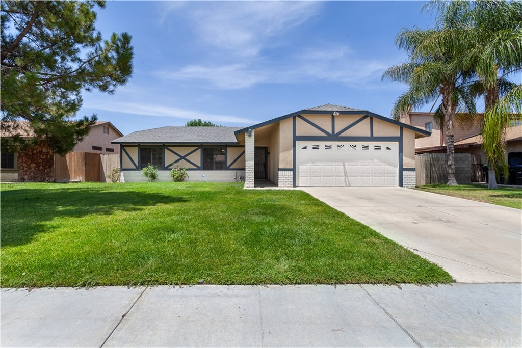 Great single-story three bedrooms two full bathroom home in a quiet Hemet neighborhood. Upon entering the home you are greeted with an open floorplan with access to the den, family room, dining area, and kitchen. The family room features a large stone fireplace that is warm and inviting, perfect for the cold nights in winter. All the bedrooms are on the south wing of the house and feature large closets and ceiling fans. The master bedroom has plenty of space with a private master bathroom. The dining area gives you access to the private backyard with a large covered patio and lush landscaping with mature trees.