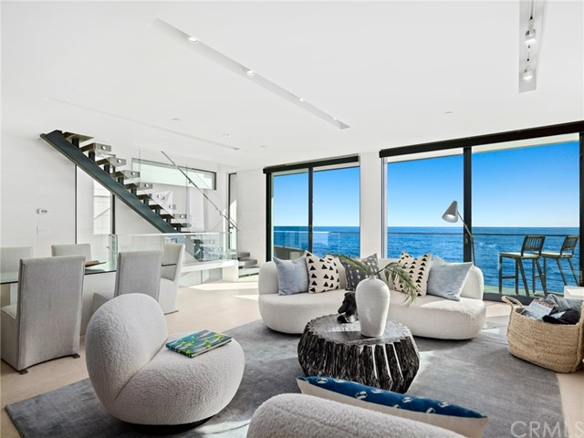 This stunning oceanfront Modern enjoys a coveted spot on the pristine sands of Brooks Street, just a stone's throw from Laguna Beach's vibrant Village. Anchored on a dramatic setting, this sleek newly constructed seaside home appears to be floating on the ocean thanks to massive walls of glass that frame panoramic Pacific, whitewater, coastline, Catalina and city-light views. The contemporary residence incorporates top materials, including limestone, weathered woods, steel and glass. The result? A stunningly impeccable design that is defined by its oceanfront setting with direct beach access. Horst Architects in concert with Brion Jeanette created the home, which provides a haven for sophisticated indoor and outdoor entertaining on a view-oriented deck and a main-level great room featuring a linear fireplace with underlit hearth, chic LED lighting fixtures, and distinctive art niches. A two-level island that is destined to be a prime spot for entertaining takes center stage in a sublime kitchen with custom European cabinetry, 2 sinks and Miele high-end appliances. Approx. 2,143 s.f., the 2-bedroom, 3-bath masterpiece separates bedrooms for maximum privacy, with a top floor dedicated to a primary suite with extraordinary ocean views, a balcony, walk-in closet, and a 5-star bath with walk-in shower. On the lower level, another ocean-view balcony complements a secondary bedroom or living/entertaining space with full bath. An elevator adds comfort and convenience on all levels. This unique oceanfront home providing a world-class space for sharing precious moments with friends and family.