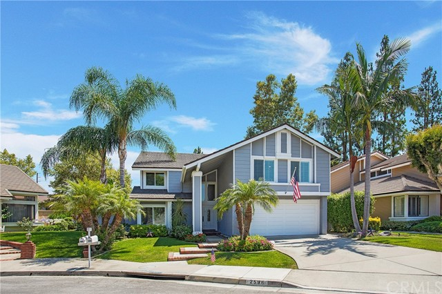 PICTURE PERFECT HOME LOCATED IN THE WELL SOUGHT AFTER COUNTRY HILLS ESTATES IN BREA! This stunning home features 4 bedrooms, 2.5 bathrooms, a large upstairs bonus room that can be easily converted to a 5th bedroom and approx. 2,748 sq. feet of living space. Take a step into this beautifully maintained home and you will notice the open layout and many additional features throughout. Wood flooring, grand staircase, plantation shutters, recessed lighting, a two car garage, this home has everything and more! The formal dining room features large windows that let in plenty of natural sunlight. The kitchen is an entertainer's dream! With dark wood cabinetry, granite counter tops, center island with a built-in warming drawer and bar seating, custom fridge panels to match the cabinetry, as well as plenty of storage. Adjacent to the kitchen is the living room which offers a relaxing fireplace accented with stacked stone. On the second level sits the spacious master bedroom complete with a beautifully upgraded bathroom featuring dual vanities, large soaking tub and additional closet space. The upstairs also features three bedrooms and a large upgraded bathroom with dual vanities. Step out the back sliding doors and into a summer paradise! The backyard is perfect for upcoming summer nights with the built in BBQ area, fire-pit sitting area, immaculate landscaping and above ground hot tub. You won't want to miss the opportunity to make this beautiful home your own!