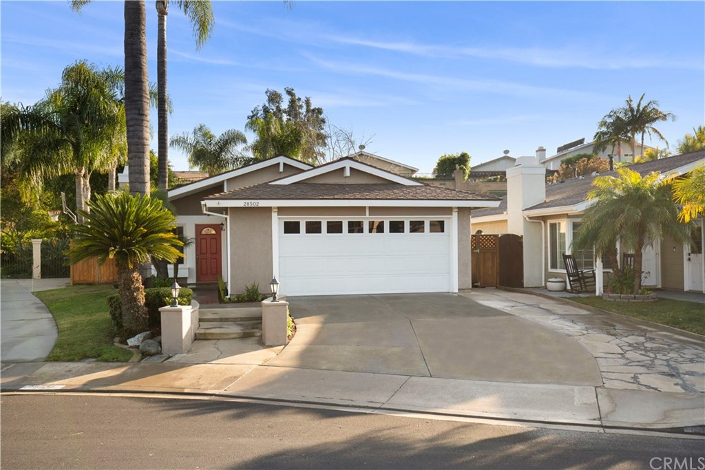 A Mission Viejo end of cul-de-sac, one story beauty! This turnkey home is located at the end of a cul de sac on an oversized lot. 3 bedroom 2 bath appx 1120 sqft.  Enter into a family room with vaulted ceiling, gas fireplace with custom mantle, ceiling fan and lighted sconces.  Remodeled family kitchen with eating area, vaulted ceiling, white cabinets with under counter pull out shelves, dark stone counter tops, stainless steel KitchenAid appliances, stainless sink, drawer and cabinet pulls. Remodeled secondary bedrooms with custom paint, crown moulding, baseboards, ceiling fan in one and barn door closet door in the other. Hall bathroom with custom sink, cabinet, mirror, tile and tub. The hallway comes equipped with 2 solar tubes for natural light. Master bedroom with vaulted ceiling, shiplap wall accents, ceiling fan, mirrored wardrobe doors w stainless accents, Closet Maid hanging shelves and drawers in master closet and sliding glass door that leads to the back yard. Remodeled master bathroom with a subway tile shower with custom glass barn door style enclosure, custom sink, cabinet, mirror and fixtures. An incredibly private entertainers rear yard completed with built in stainless BBQ & eat at bar, sitting area with fireplace, lot of grass, raised planter box and trees for shade.  This home also has vinyl windows, window blinds and beautiful durable laminate flooring through out.  Member of Lake Mission Viejo.