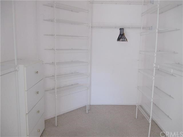 Master walk in closet offers lot of storage and shelving